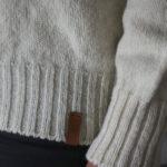 Détail pull pure laine éthique Made in France